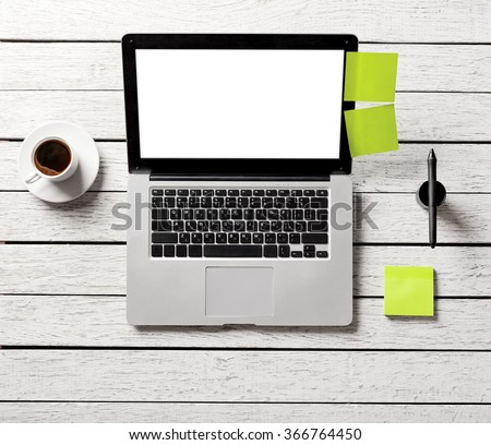 Mockup open laptop, coffee cup and sticky notes on wood table. Simple creative workspace. Clipping path included. - stock photo