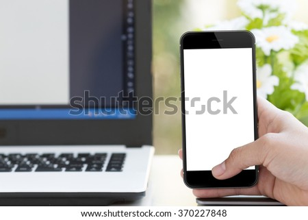 mockup phone in woman hand on desk - stock photo
