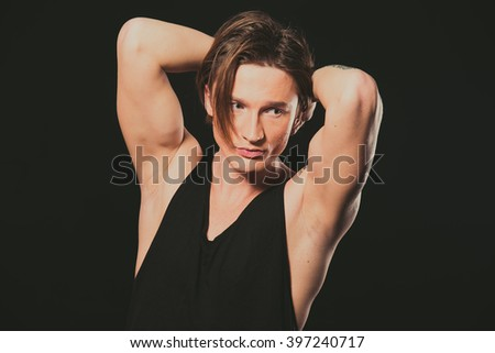Model. A young guy in a black shirt and jeans.