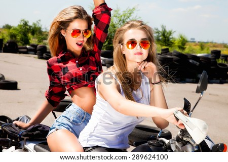 Model at the car wash in garage.Cross processing.Girls having fun and travel on holidays on motorbike,travel motorcycle,hikers,girls riders,dirty ride,stylish summer girls,hipster girl,denim shorts - stock photo