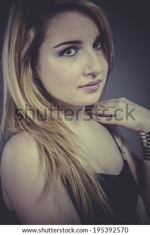 Model Beautiful blonde with silver jewelry and long hair - stock photo