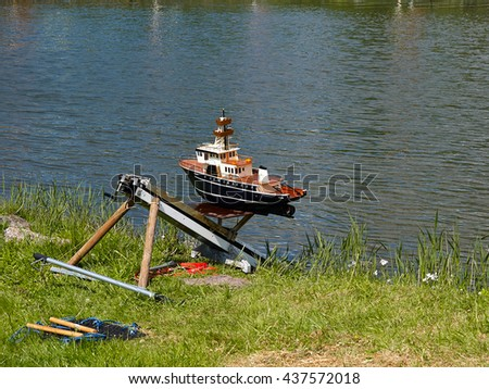 Model boat boating hobby leisure time outdoors activity - stock photo