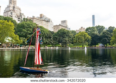 model boats sailing on Conservatory Water in central park in manhattan, new york city - stock photo