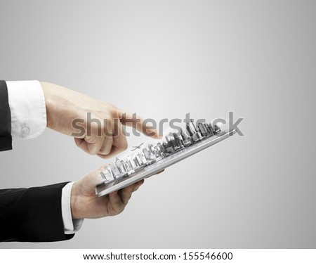 model city in digital  touch pad - stock photo