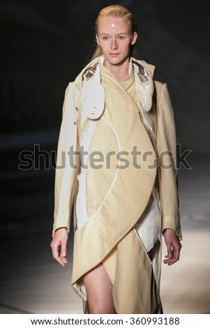 Model Edythe Hughes walks the runway at the Threeasfour fashion show during New York Fashion Week Spring Summer 2016 at Pier 59 on September 14, 2015 in New York City - stock photo
