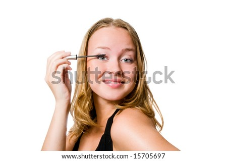 Model getting mascara applied.