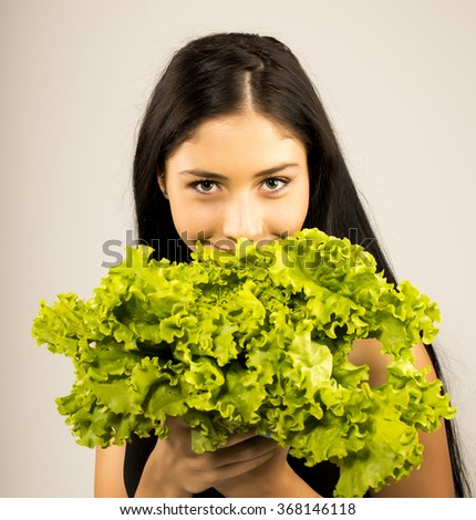 model girl with Lettuce. Beautiful happy young woman with green vegetables - stock photo