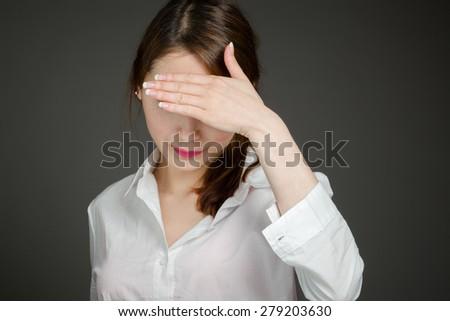 Model hiding face shame - stock photo