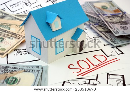 Model  house and construction plan with the word sold   - stock photo