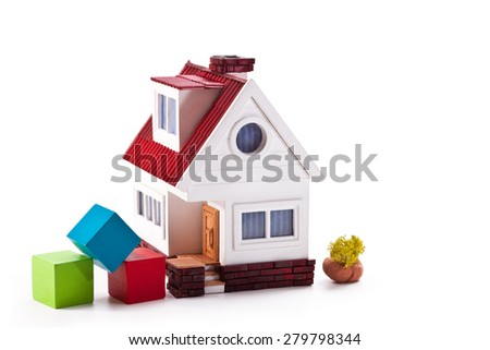 Model house and red, blue, green cubes on a white background - stock photo