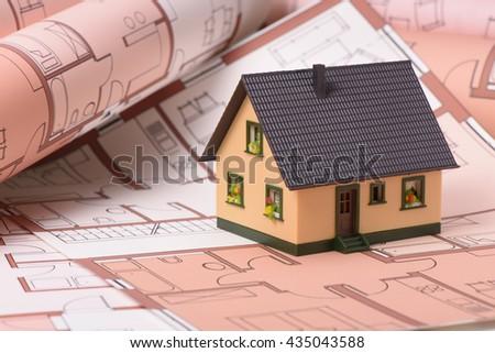 model house on construction plan - stock photo