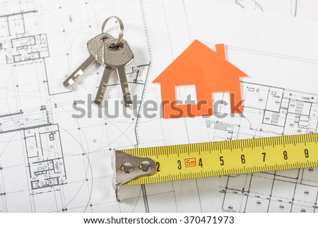 Model house on construction plan for house building, keys and divider compass. Real Estate Concept.