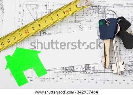 Model house on construction plan for house building, keys, clipboard and white blank. Real Estate Concept. - stock photo