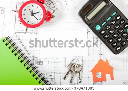 Model house on construction plan for house building, keys, red alarm clock and calculator. With white blank business card. Real Estate Concept.