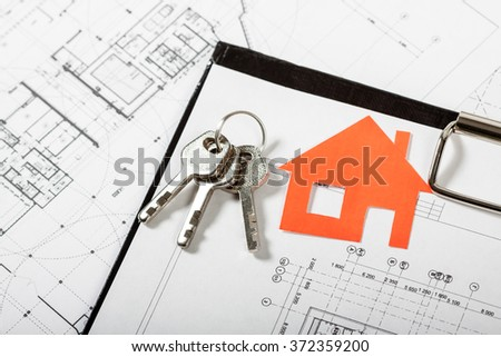 Model house on construction plan for house building with keys . Real Estate Concept. - stock photo
