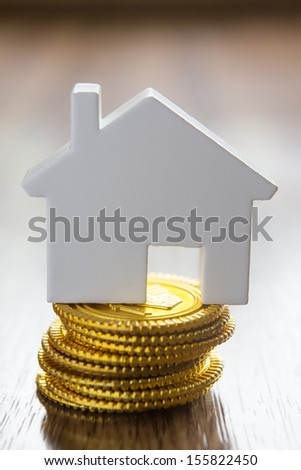 Model House On Stack Of Gold Coins - stock photo