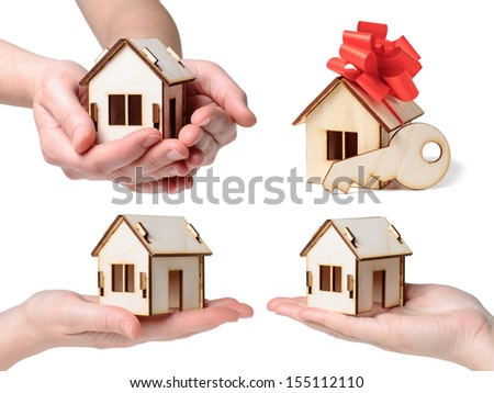 Model house set with hands, bow and key   isolated on white background