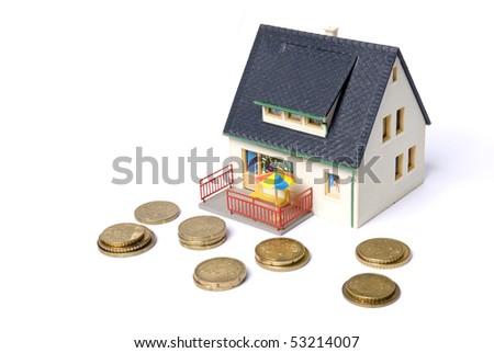 model house with pile of coin
