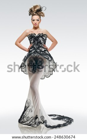 Model in a fashion long dress with creative coiffure and make up - stock photo