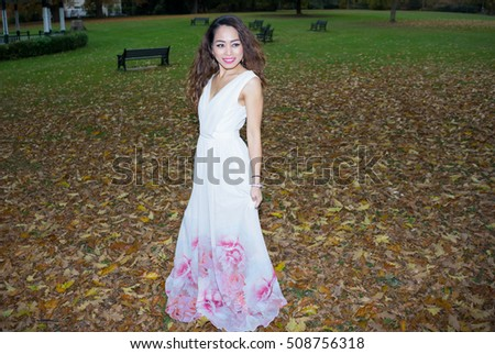 Model in a White Dress in Autumn