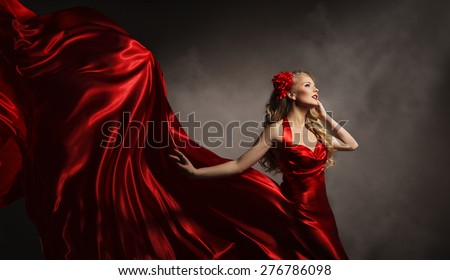 Model in Red Dress, Glamour Woman Posing in Flying Long Silk Cloth on Wind, Beauty Fashion Portrait - stock photo
