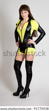 Model in sexy yellow and black outfit with thigh high boots and garter
