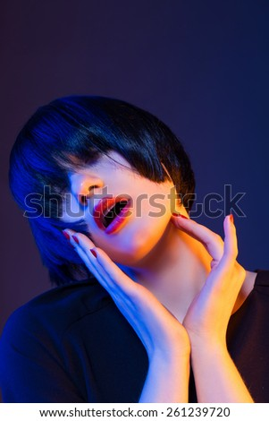 model in studio on a black background - stock photo