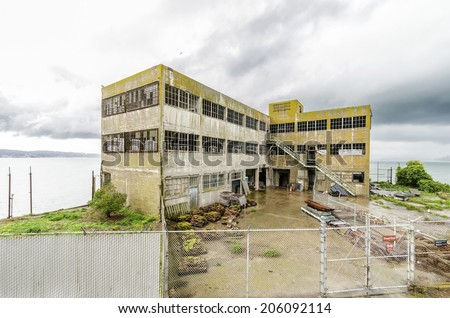 Model Industries Building on Alcatraz Penitentiary in San Francisco, California. An old, moldy, haunting building, which was used by the prisoners as a laundry room where inmates worked. - stock photo