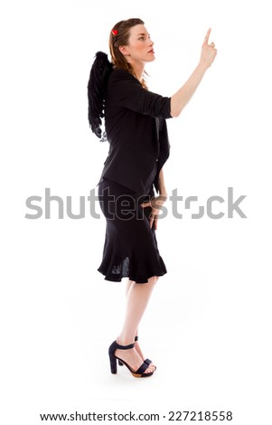 model isolated on plain background back pointing