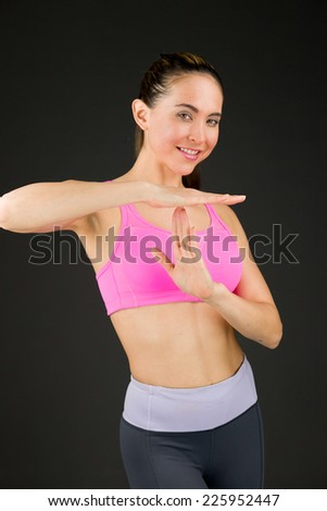 model isolated on plain background hand gesture break sign