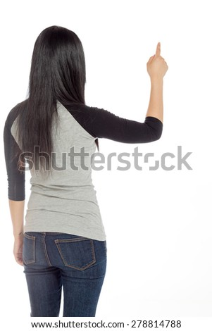 Model isolated on plain background in studio from rear pointing - stock photo