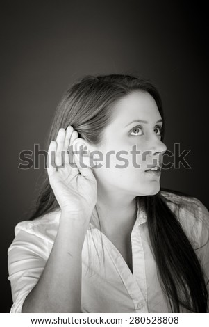 model isolated on plain background listening paying attention - stock photo