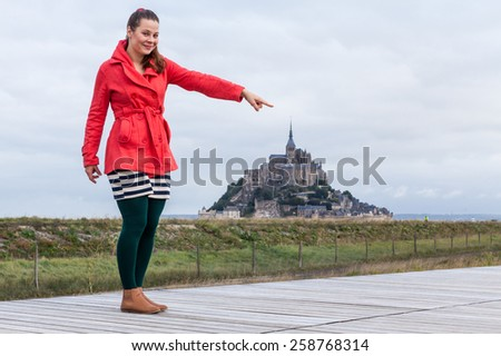 Model Jana in front of Mont Saint-Michel, France - stock photo