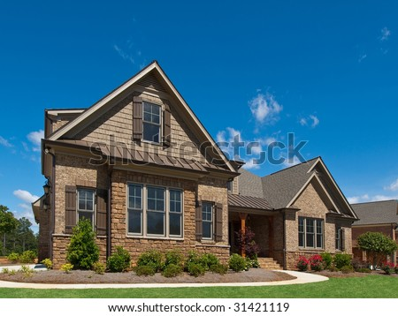 Model Luxury Home Exterior angle view with sidewalk