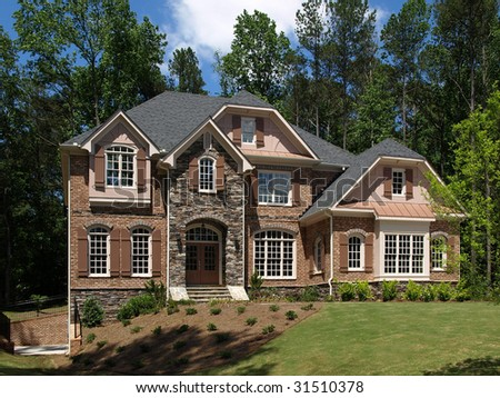 Model Luxury Home Exterior front view sloping yard - stock photo