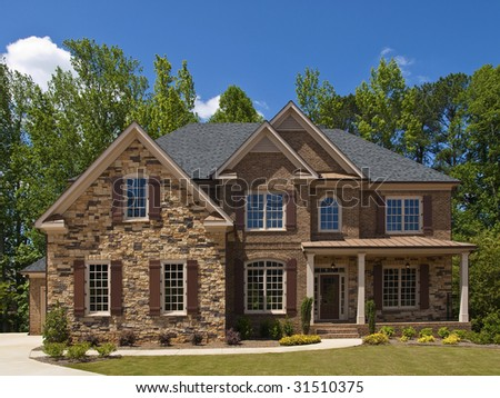 Model Luxury Home Exterior front view with porch