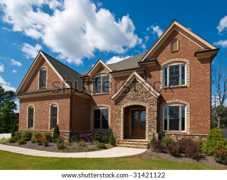 Model Luxury Home Exterior with clouds side view - stock photo