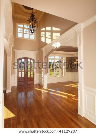 Model Luxury Home Interior Front Entrance Arch Way - stock photo