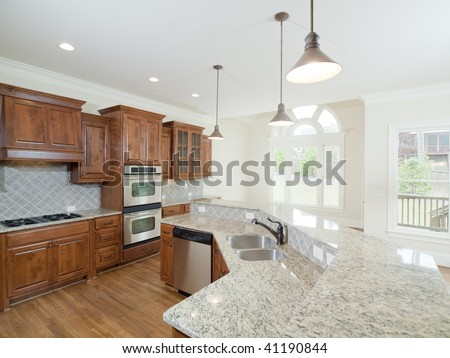 Model Luxury Home Interior Kitchen with arch window - stock photo