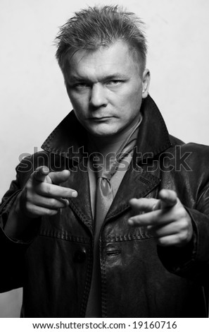 model man in black leather jacket on gray background - stock photo