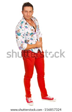 Model man posing in floral shirt and red pants isolated on white background