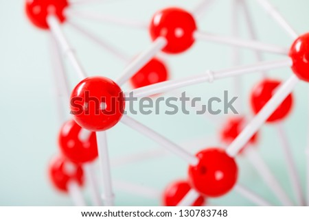 Model of copper molecular structure on green reflective background - stock photo