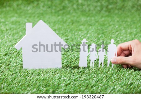 Model of family and house in grass