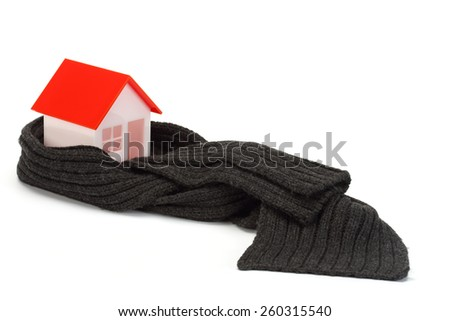 Model of house wrapped in dark scarf over white - stock photo