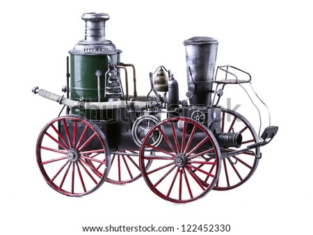 Model of old-fashioned train isolated over white background - stock photo