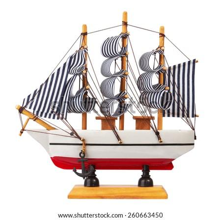 Model of sailing ship isolated on white background. - stock photo