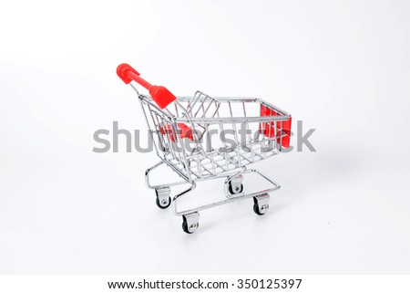 Model of supermarket trolley on white background.