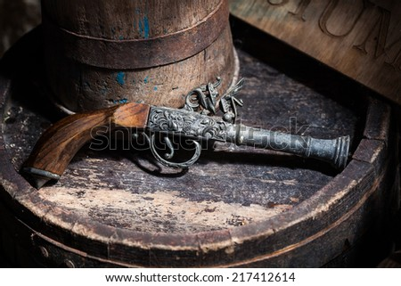 Model of the old vintage gun on wooden background - stock photo