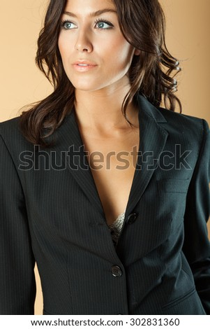 Model poses in jacket with exposed bra - stock photo