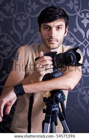 Model posing as a photographer - stock photo